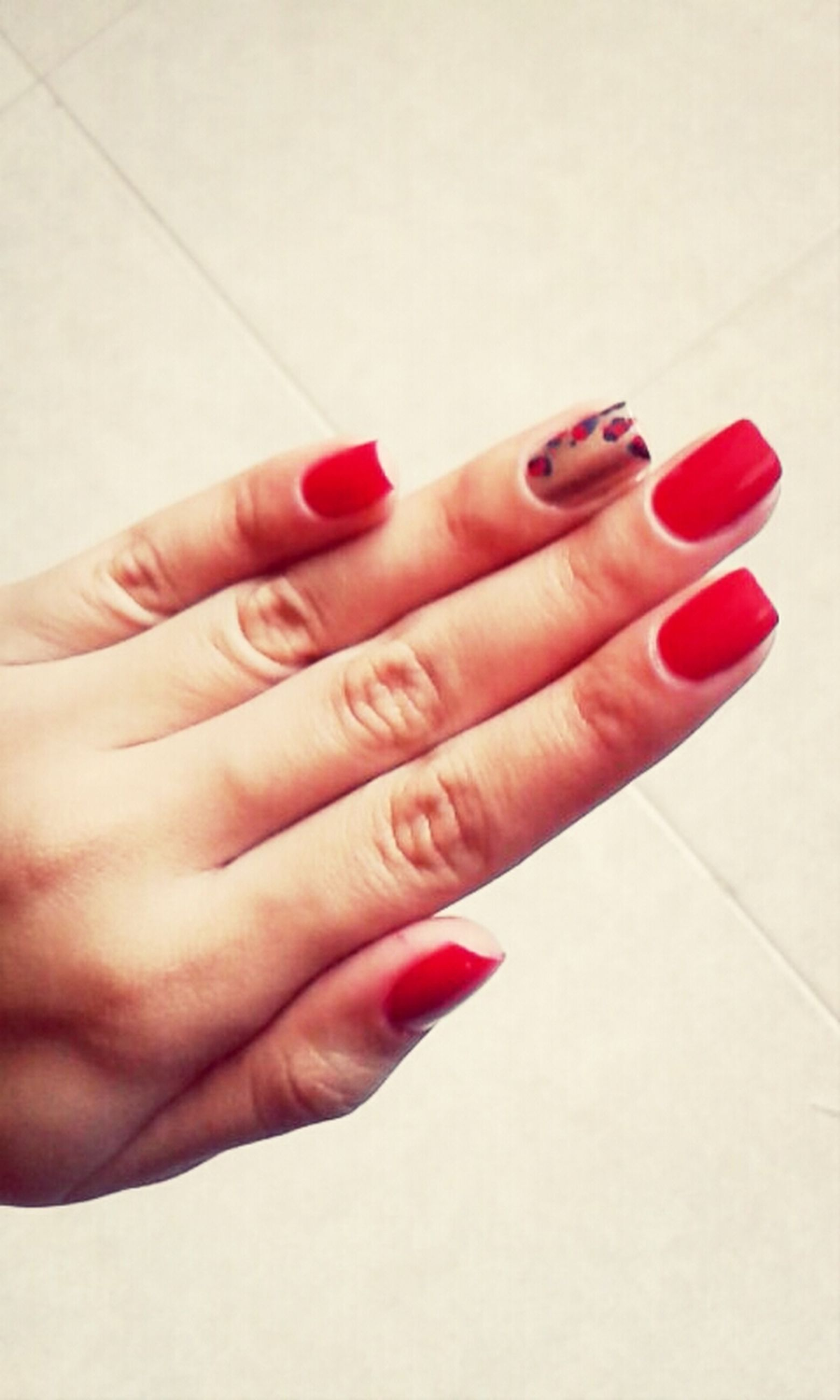 person, part of, indoors, human finger, cropped, holding, red, close-up, nail polish, white background, lifestyles, studio shot, unrecognizable person, high angle view, personal perspective, red nail polish