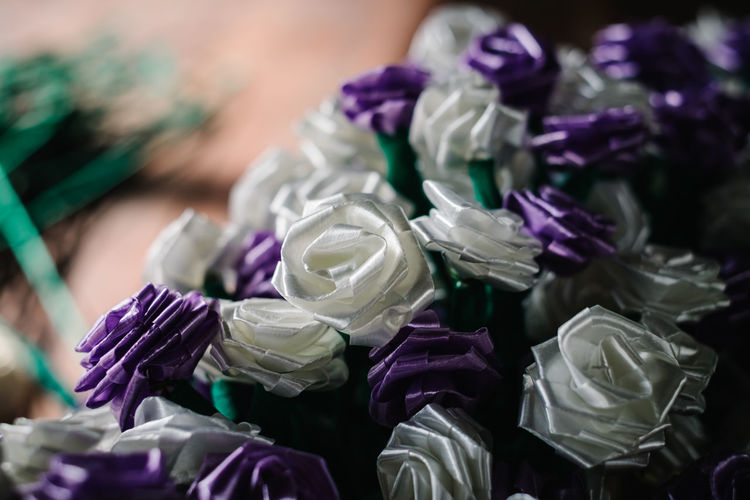 handcrafted flowers, copy space Burial Business Isolated Objects Abundance Art Backgrounds Choice Close-up Condolence Craft Decoration Design Finance Flower Funeral Handcraft High Angle View Large Group Of Objects Lenten Multi Colored Occasion Purple Selective Focus Variation