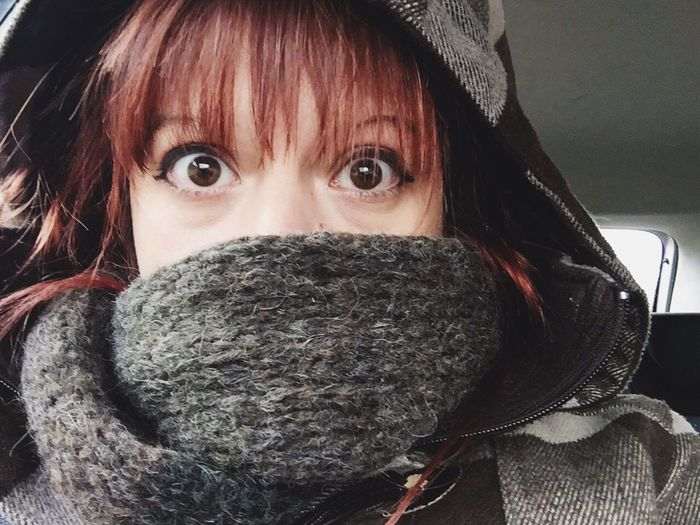 Close-Up Portrait Of Young Woman With Obscured Face Traveling In Car