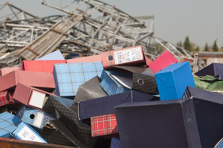 Pile of folders against sky