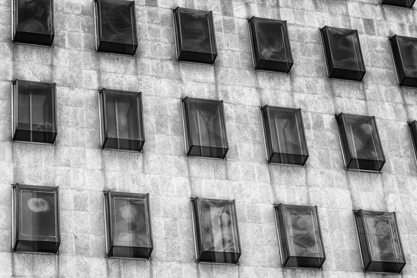 Apartment Architecture Array Backgrounds Building Exterior Built Structure City Life Conformity Day Façade Full Frame In A Row Investment Low Angle View Low Angle View No People Office Building Order Outdoors Pattern Repetition Window Windows