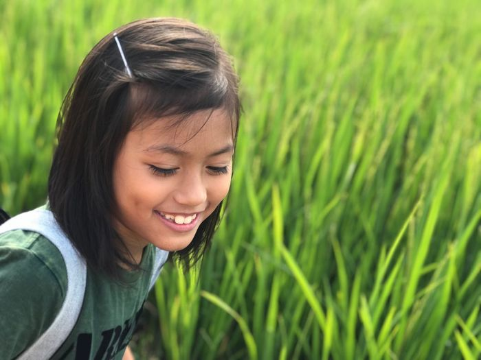 Close-Up Of Smiling Girl On Field