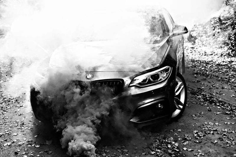 Smoking Car Blackandwhite Photography Blackandwhite F22 Bmw Transportation Mode Of Transportation No People Land Vehicle Day Motor Vehicle Nautical Vessel Car Nature Smoke - Physical Structure Outdoors Motion City High Angle View Auto Post Production Filter Close-up