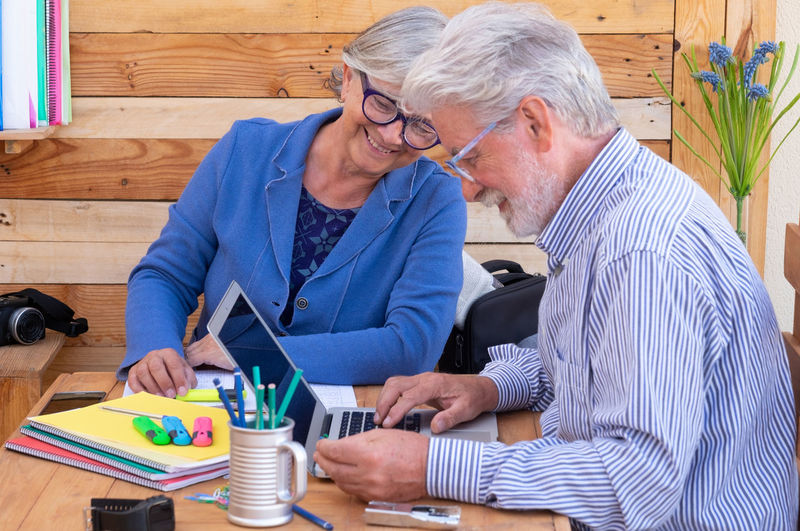 Man and woman using laptop on table