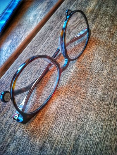 Resting on the bar Spectacles Table Bar Lunch Time! Eyesight Eyeglasses  Eyewear Glasses Table Vision Sunglasses Cool Still Life Close-up Wooden Personal Accessory Trendy Transparent Circular Personality  Character Contemporary