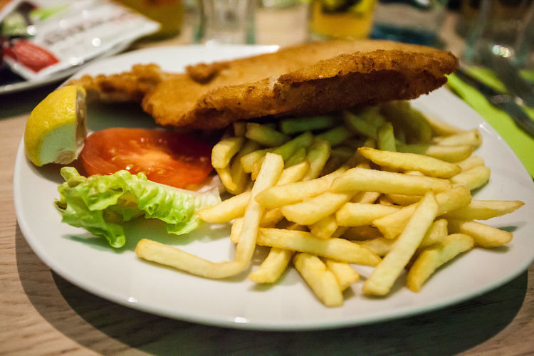 Wiener schnitzel The Traveler - 2018 EyeEm Awards The Still Life Photographer - 2018 EyeEm Awards Vienna Wiener Schnitzel Close-up Day Fast Food Food Food And Drink French Fries Freshness Indoors  No People Plate Prepared Potato Ready-to-eat
