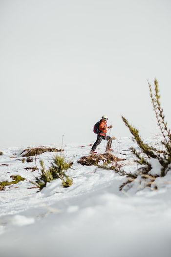 Full length of man walking on snow covered land