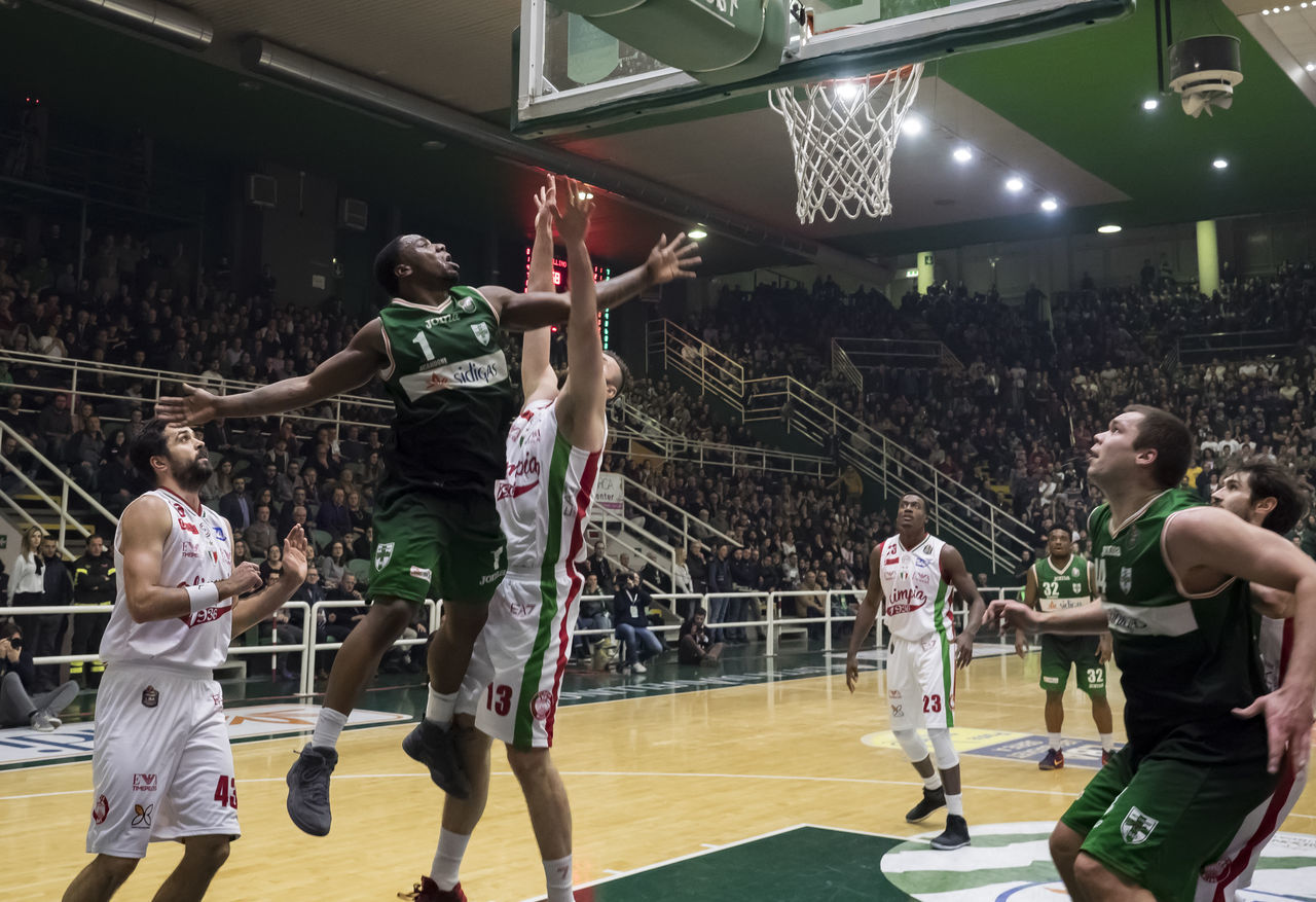 real people, basketball - sport, playing, large group of people, competition, basketball player, sport, indoors, men, competitive sport, lifestyles, teamwork, sports team, court, sportsman, athlete, day, people