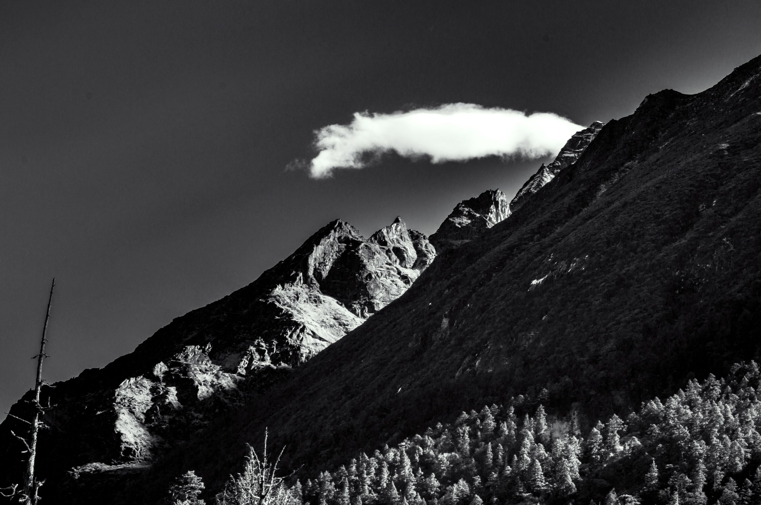 mountain, mountain range, sky, scenics, tranquil scene, tranquility, beauty in nature, snowcapped mountain, nature, landscape, rocky mountains, non-urban scene, cloud - sky, mountain peak, physical geography, weather, idyllic, cloud, majestic, season, remote, geology, day, rock formation, outdoors, no people, cloudy, non urban scene, snowcapped, blue