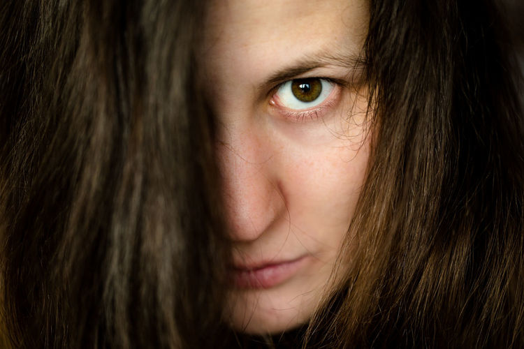 Close-up One Person Brown Hair Emotion Human Face Portrait Long Hair Headshot Women Hairstyle Young Adult Females Real People Human Hair Teenager Aggression  Bruise Hair Human Body Part Eyes Girl Take A Look Demons Demonic Face Threatening Brown Eyed Girl Brown Eyes