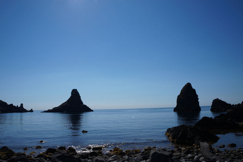 Catania, Sicily Cyclops' Coast Sicily Sicily, Italy Sicily's Riviera Dei Ciclopi Beauty In Nature Blue Clear Sky Day Mountain Nature No People Outdoors Riviera Dei Ciclopi Rock - Object Rock Formation Scenics Sea Sky Tranquil Scene Tranquility Water