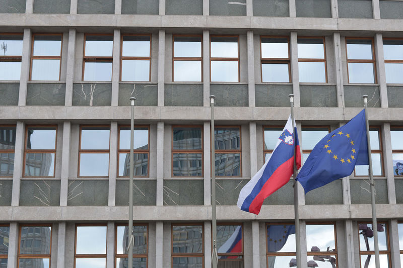Low angle view of flags against building