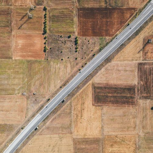 Aerial View Of Road Amidst Field