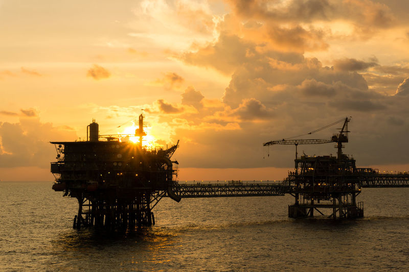 golden hour offshore Power Engineering Structure Ocean Offshore Offshore Life Platform Production Upstream Golden Hour Petroleum Oil And Gas Evening Cloudy Drilling Rig Offshore Platform Oil Pump Sea Oil Industry Sunset Gasoline Water Industry Silhouette Fossil Fuel Oil Field Gas Oil Natural Gas Crude Oil