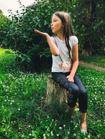 Air kiss Air Kissing Cute Girl Beautiful EyeEm Selects One Person Plant Leisure Activity Real People Lifestyles Casual Clothing Day Child Young Women Girls Green Color Grass Teenager Hairstyle This Is Natural Beauty This Is Natural Beauty