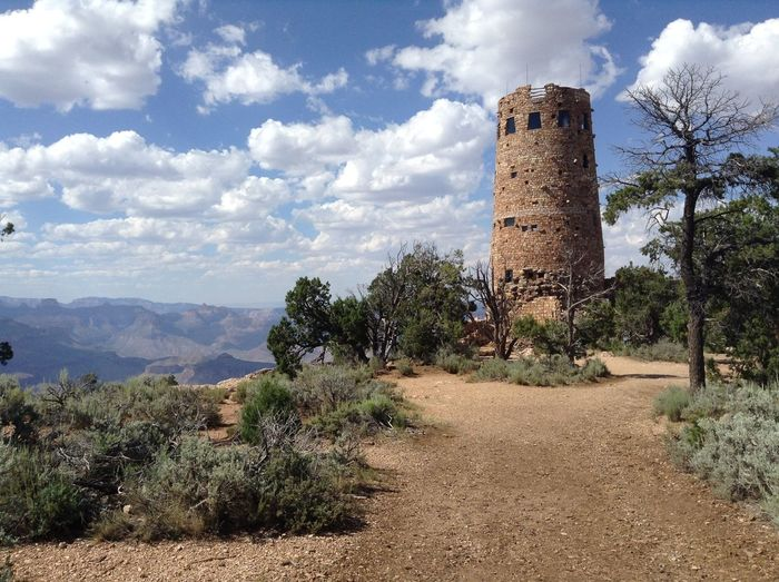 Ancient Lookout Tower Against Cloudy Sky