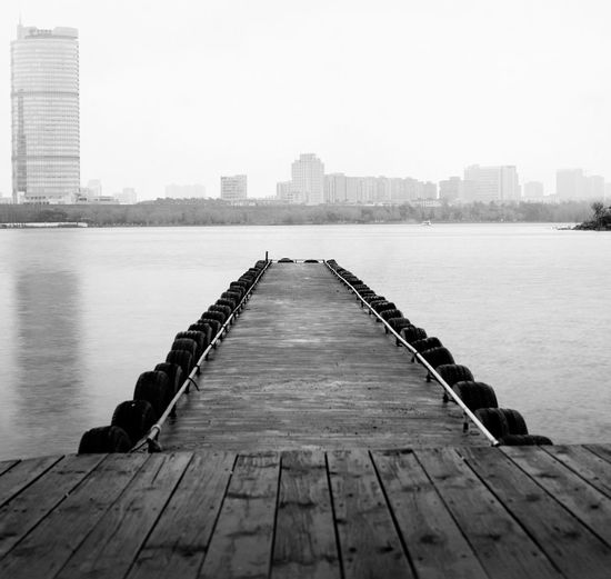 #China  #hasselblad #mediumformat #nanjing Architecture Building Exterior Built Structure City Cityscape Day Jetty No People Outdoors Pier River Sky Skyscraper The Way Forward Travel Destinations Urban Skyline Water Wood - Material Wood Paneling