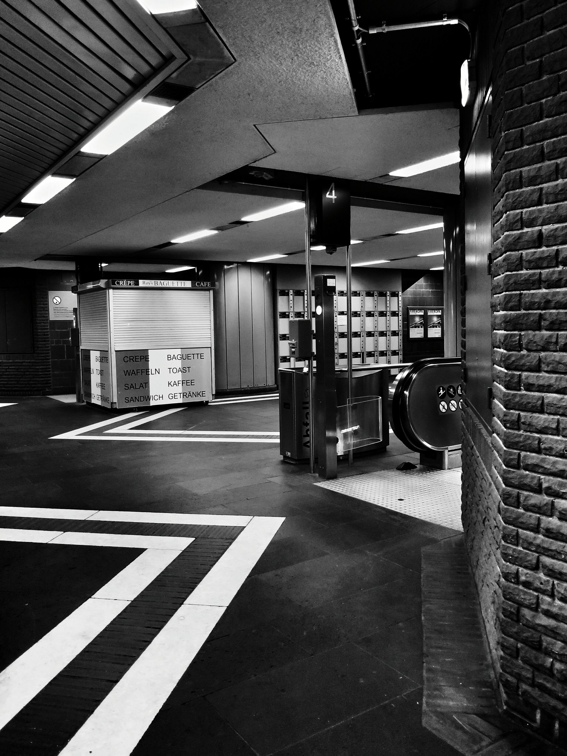 architecture, built structure, building exterior, city, empty, shadow, sunlight, the way forward, modern, building, indoors, city life, street, tiled floor, incidental people, day, transportation, absence, no people, road marking
