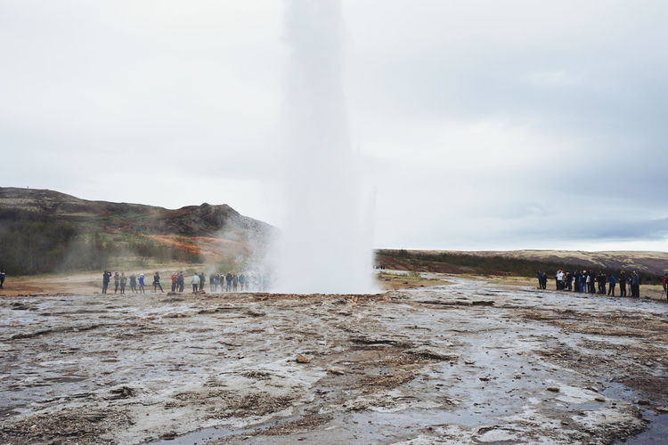 Geyser, Iceland Beauty In Nature Day Erupting Geology Geyser Heat - Temperature Hot Spring Iceland Large Group Of People Leisure Activity Long Exposure Men Motion Nature Outdoors Physical Geography Power In Nature Real People Splashing Steam Tourism Travel Travel Destinations Volcanic Landscape Water The Great Outdoors - 2017 EyeEm Awards Lost In The Landscape