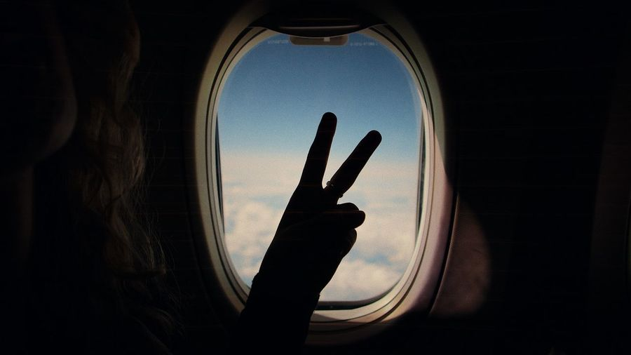 EyeEm Selects Peace Plane Sign Signs Silhouette The Week On EyeEm Airplane Close-up Day Gesturing Hand Sign Human Body Part Human Finger Human Hand Indoors  One Person Peaceful Sky Window