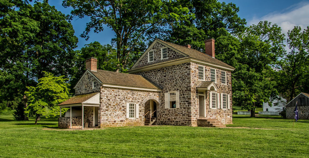 This is a photo of George Washington's Headquarters in Valley Forge National Park. While there are many building in Valley Forge National Historical Park that are original to the time of the encampment, none holds more historical significance than Washington's Headquarters. For most of the six-month encampment, Washington made his home in this stone building, meeting with advisers as they made plans, not only for the encampment, but the continuation of the war. Architecture Beauty In Nature Blue Built Structure Day Exterior EyeEm Best Shots Façade George Washington Grass Grassy Green Green Color Growth Lawn Lush Foliage Nature No People Outdoors Plant Revolutionary War Sky This Week On Eyeem Tranquility Tree