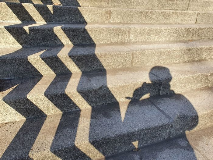 Shadow of people on staircase