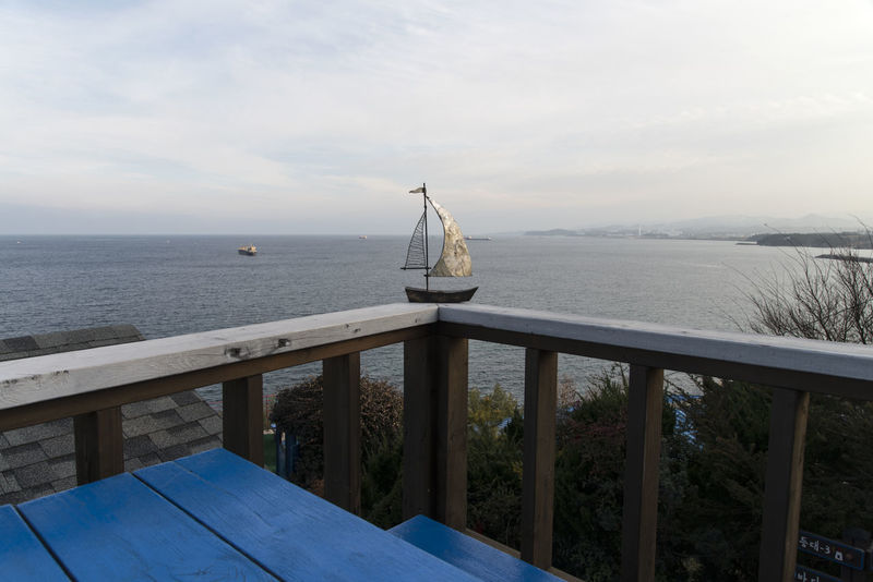 Mukho Lighthouse in Donghae City, South Korea Beauty In Nature Bench Cafeteria Coin-operated Binoculars Day Horizon Over Water Nature No People Outdoors Railing Railings Scenics Sea Seaside Ship Miniature Sky Telescope Tranquility Water