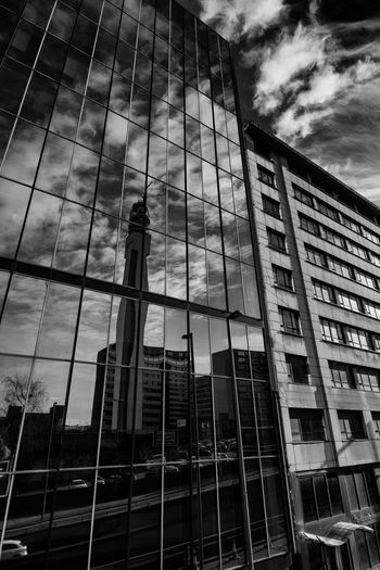 reflection of Birmingham landmark bt tower Architecture Birmingham UK Blackandwhite BT Tower Cars Glass Low Angle View Reflection Sky And Clouds