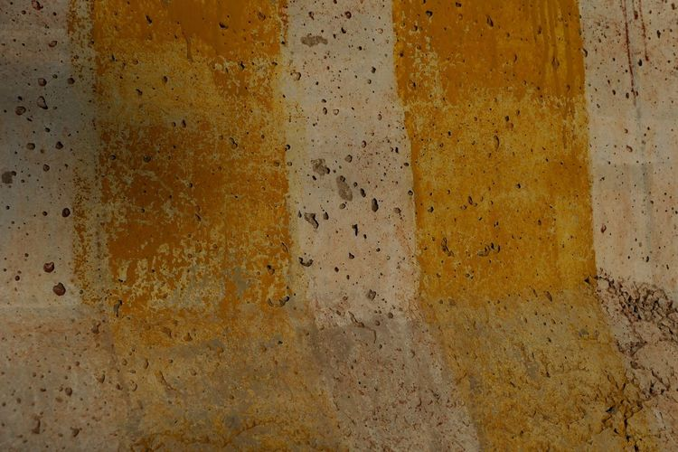 Backgrounds Textured  Full Frame Yellow Wall - Building Feature Pattern No People Weathered Dirty Old Built Structure Architecture Rough Close-up Damaged Concrete Abstract