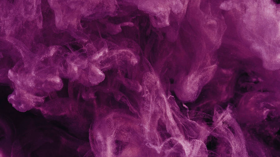 Close-up of purple ink in water