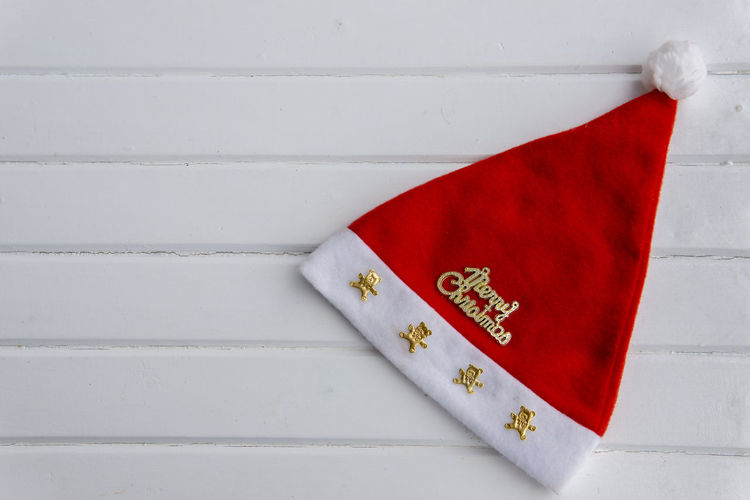 Christmas Hat Christmas Hat Xmas Architecture Close-up Communication Craft Decoration Envelope Flag Indoors  No People Non-western Script Paper Pattern Red Script Still Life Text Wall - Building Feature Western Script White Color