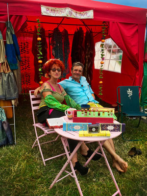 Adult Adults Only Ali And Tim Barrow Of Love Casual Clothing Chair Day Enjoyment Food And Drink Friendship Full Length Leisure Activity Men Only Women Outdoors People Table Togetherness Two People Womad Festival Women Young Adult Young Women