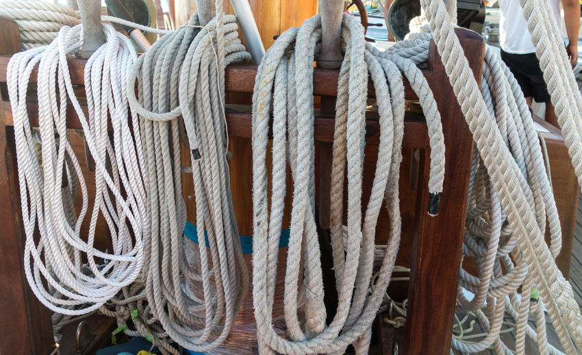 Close-up of tied hanging on rope
