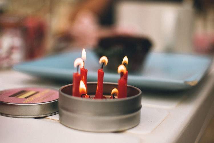 Burning Fire Flame Candle Heat - Temperature Indoors  Fire - Natural Phenomenon Close-up No People Selective Focus Focus On Foreground Table Illuminated Candlestick Holder Glowing Domestic Room Nature Metal Wax Arts Culture And Entertainment Birthday Birthday Cake
