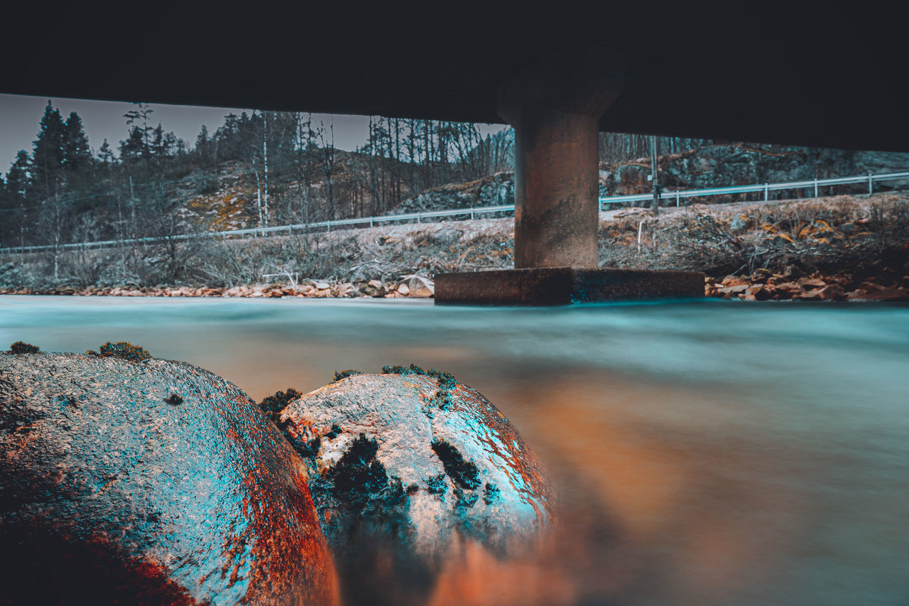 SCENIC VIEW OF RIVER BY ROCKS