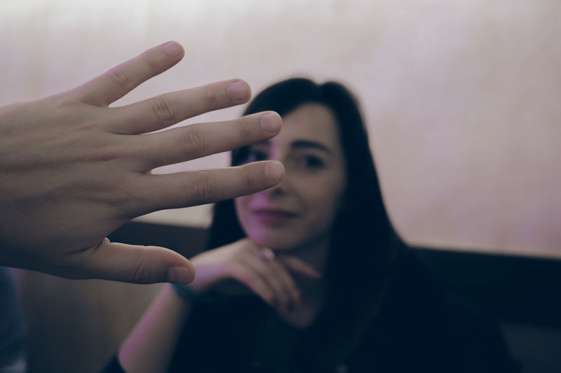 Close-up of woman with hands