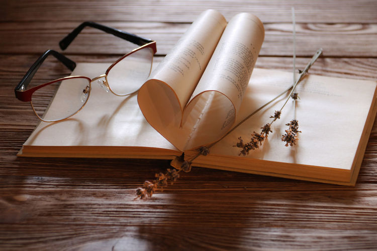 Happy Valentines Day ;) Copy Space Wood - Material Table Indoors  Still Life No People Publication Book Glasses Eyeglasses  Creativity Personal Accessory High Angle View Communication Brown Paper Read A Book Natural Light Love Poems Valentine's Day  Pages Heart Sentimental