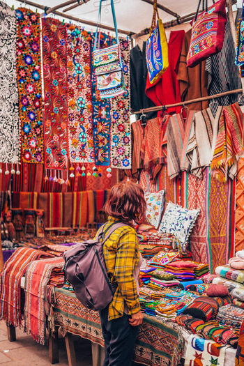 Rear view of multi colored market stall for sale