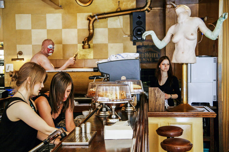 Young female staff busy at work at a cafe restaurant Busy Busy Street Cat Chores Cleaning England Food Hospitality Indoors  Interior Job Minimum Wage Non Stop  People Real People Restaurant Routine Sculpture Shift EyeEmNewHere Waitress Weekend Work Work Young Adult Young Women