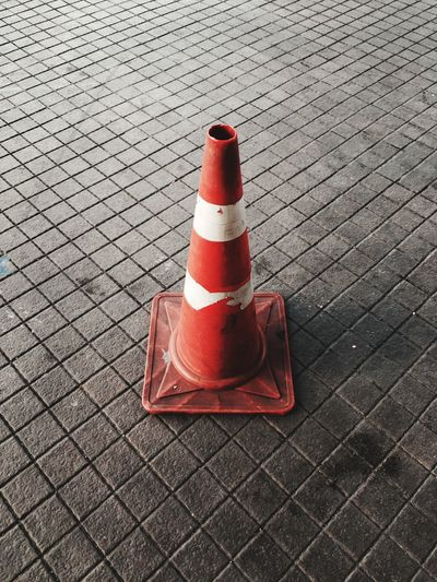 High angle view of traffic cone on footpath