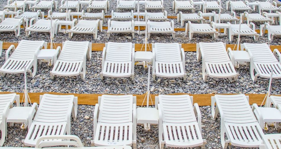 High angle view of lounge chairs at beach