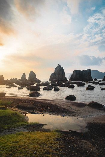 Sea Rock - Object Rock Formation Sky Nature Tranquility Beauty In Nature Cloud - Sky Tranquil Scene No People Scenics Water Beach Outdoors Sunset Day EyeEm Nature Beauty In Nature Fujifilm Tourism Orange Color Place Of Worship Lifestyles Tranquility