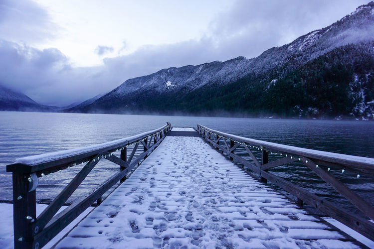 Lake Crescent, Olympic National Park in Clallam County, Washington, United States December 2017 Lake Crescent, Washington. Olympic National Park Shades Of Winter Beauty In Nature Cloud - Sky Cold Temperature Day Jetty Lake Landscape Mountain Mountain Range Nature No People Outdoors Scenics Sky Snow The Way Forward Tranquil Scene Tranquility Tree Water Weather Winter The Traveler - 2018 EyeEm Awards The Great Outdoors - 2018 EyeEm Awards