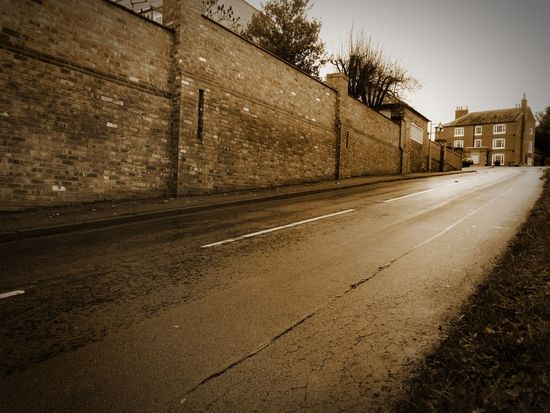 Grey Sky Built Structure Road Outdoors Day Sky No People Sepiatone Sepia Greyskys Huawei Photography Leicestershire Low Angle View HuaweiP9 Brick Wall Old Wall Huaweiphotography Diagonal Lines Village Architecture Building Exterior The Way Forward