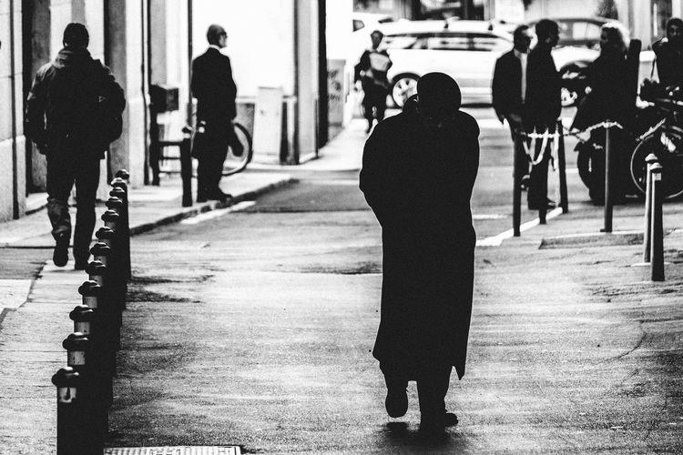 Full Length Of Man Walking On Street