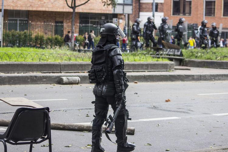 Policemen standing on street