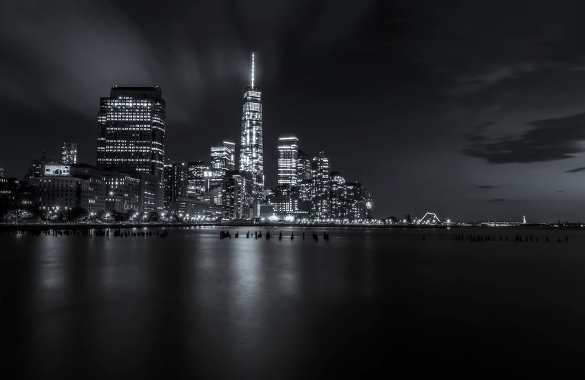 Copy Space Downtown Manhattan Night Lights Architecture Black And White Building Exterior City Cityscape Crowded Distant Illuminated Long Exposure Majestic Modern Night No People Office Block One World Trade Center Outdoors Skyscraper Travel Destinations Urban Skyline Water Waterfront