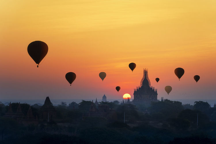 Sunrise many hot air balloon in bagan, myanmar. bagan is an ancient with many pagoda of  temples.