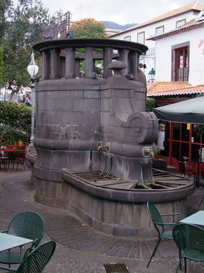 Unusual Old Water Fountain, Old Funchal City Cloudy Sky Composition Fountain Funchal Madeira Madeira Island Portugal Shaded Tables And Chairs Tourist Attraction  Unusual Cafe Full Frame Granite Granite Stone History No People Old City Outdoor Photography Restaurant Travel Destination Tree Water Fountain