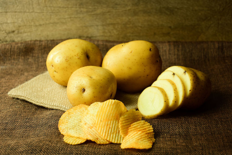 Potato Salt Snack Wood Brown Close-up Day Delicious Fat Food Food And Drink Freshness Fruit Healthy Healthy Eating Indoors  No People Nutrition Oil Potato Chip Potatoes Rough Sack Unhealthy Eating Vegetable